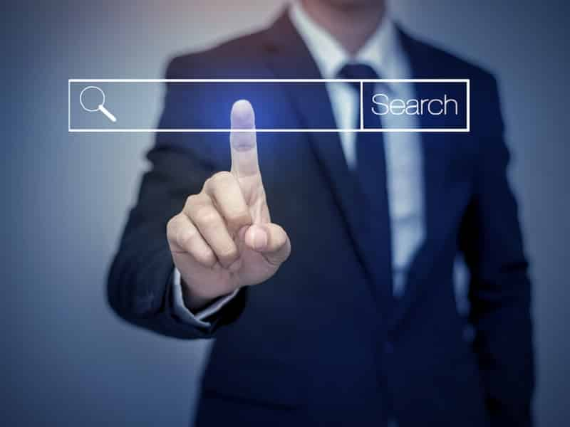 man pointing to search bar