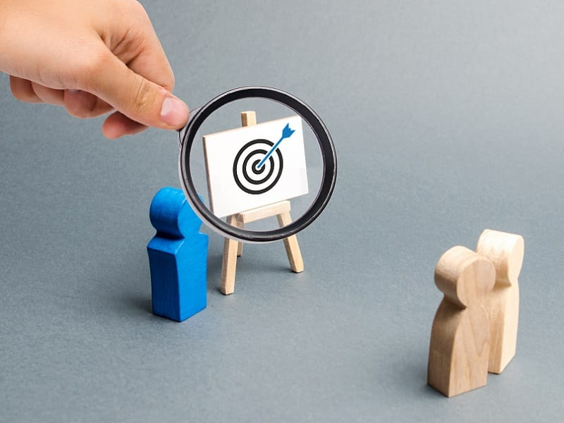target with magnifying glass