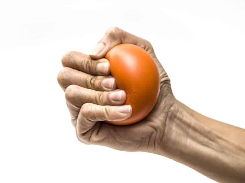 hand gripping stress ball