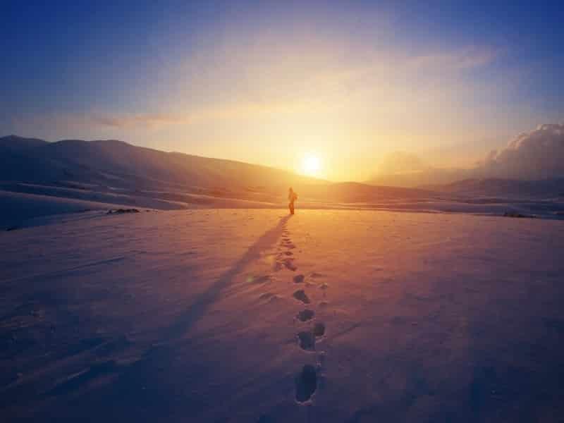 footprints on beach sunset