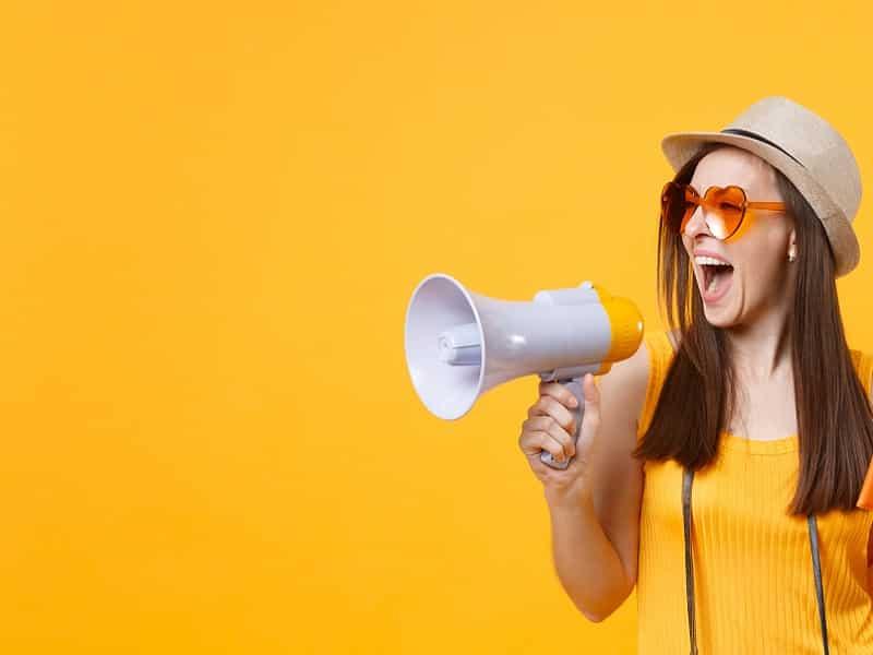 woman shouting through loudhailer