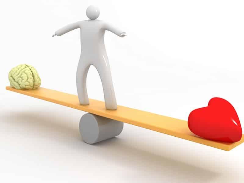figure balamce head and heart on seesaw