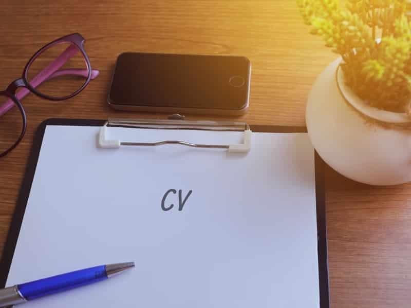 Clipboard with CV written