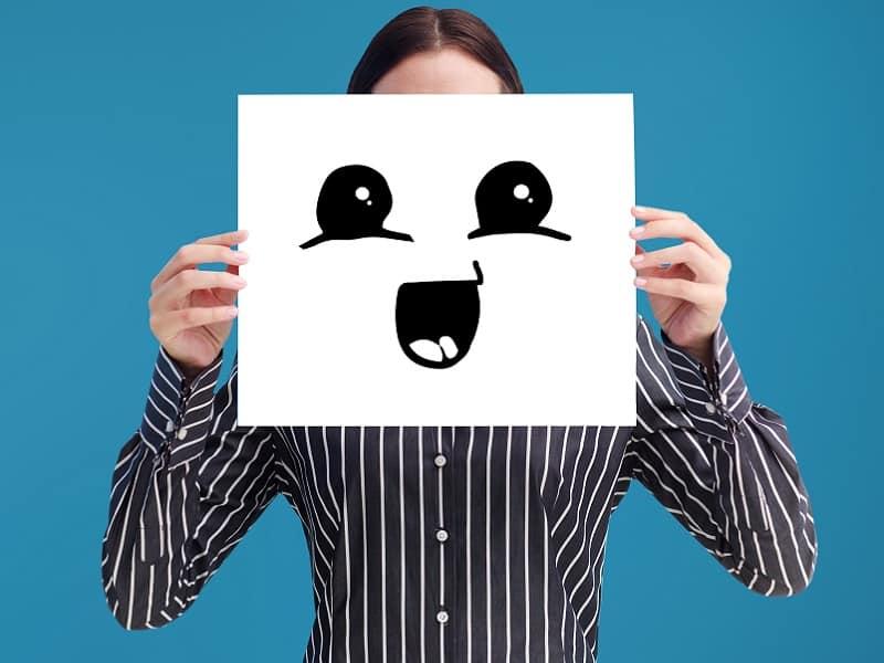 woman holding cartoon face