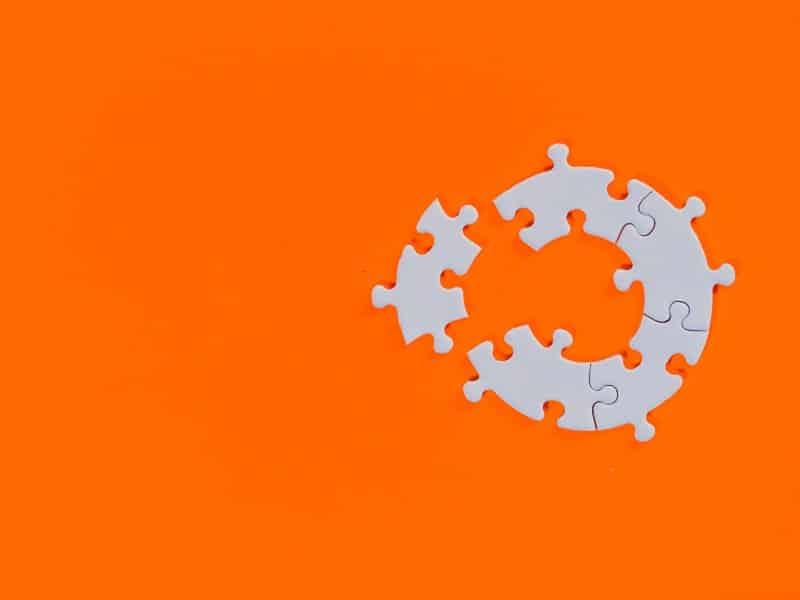 orange background white jigsaw