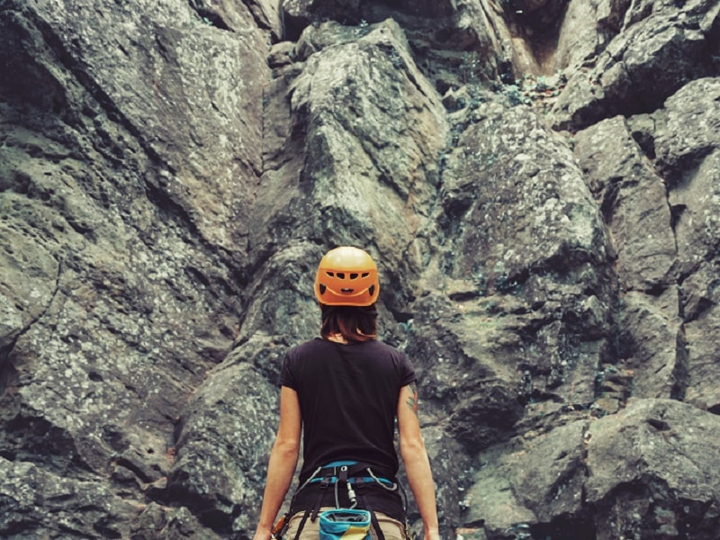 woman in front of rock face
