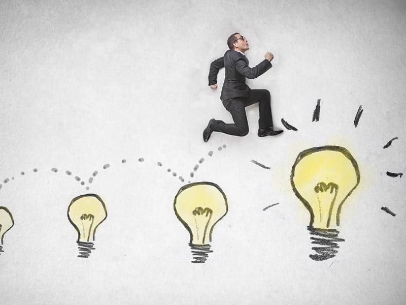 man jumping across lightbulbs