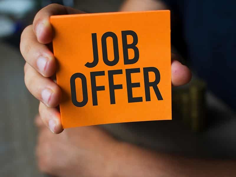holding card with job offer