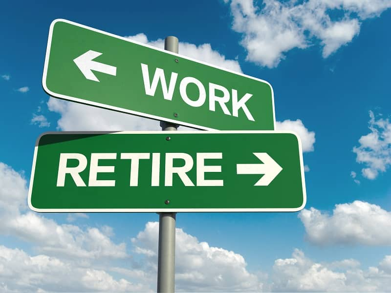 Sign pointing to work and retire