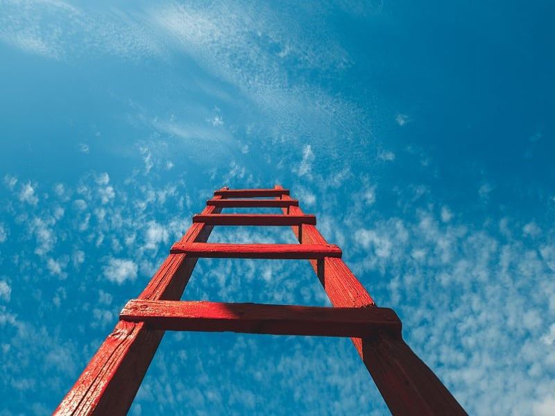 red ladder up to sky
