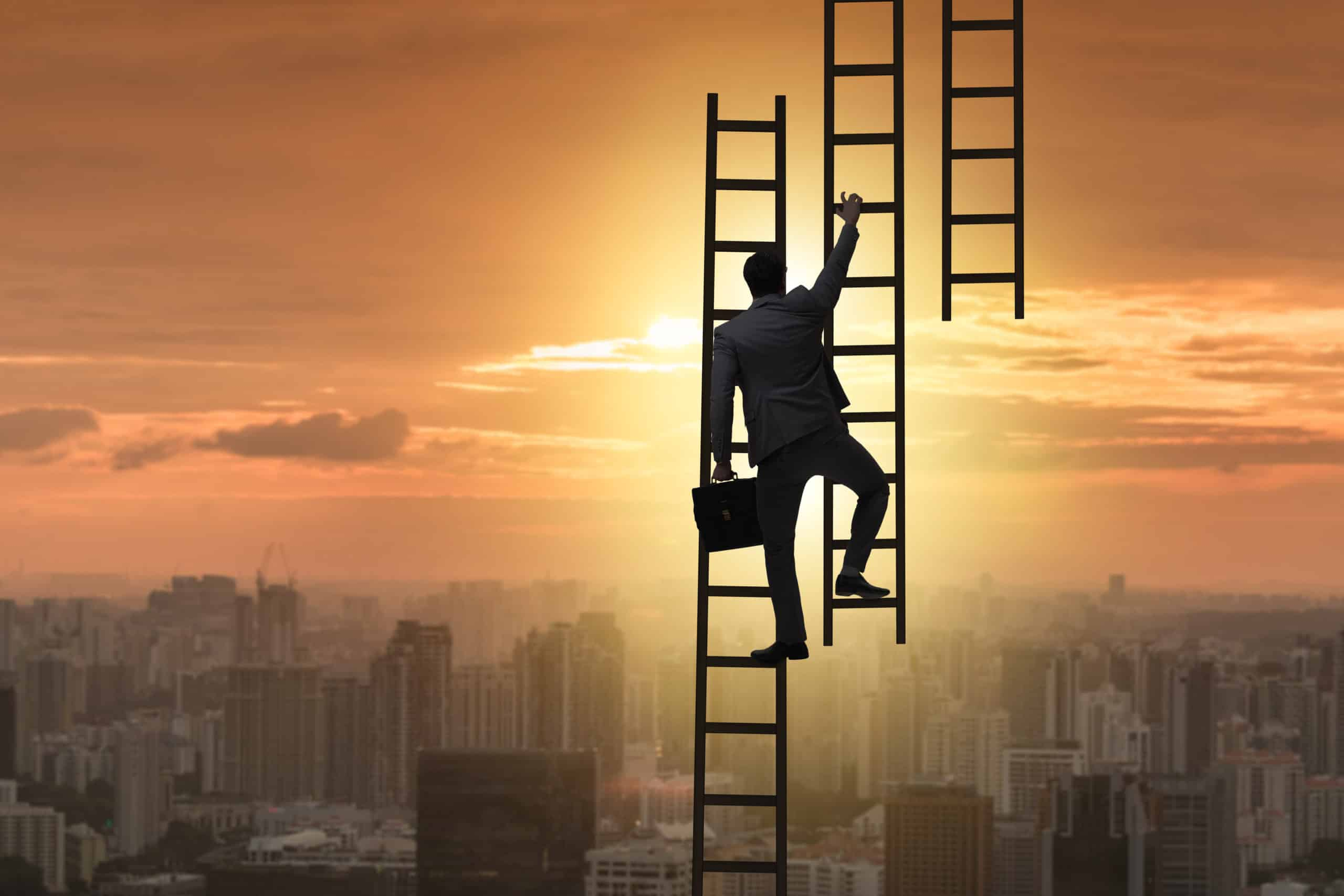 climbing ladder in business suit