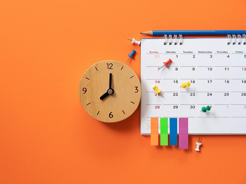 claendar, clock on orange background