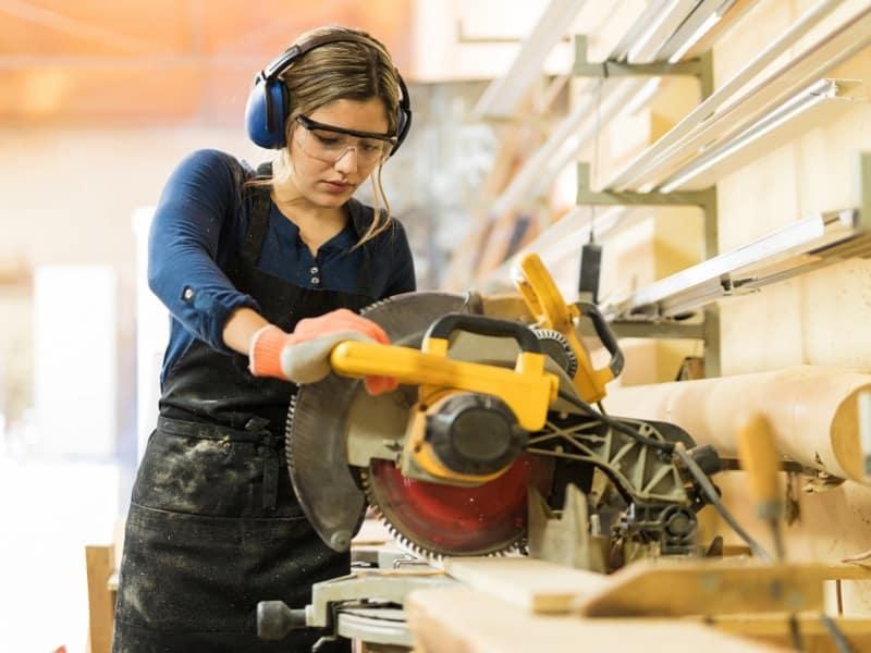 woman working machinery