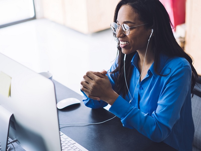 woman in blue shirt talking on video call
