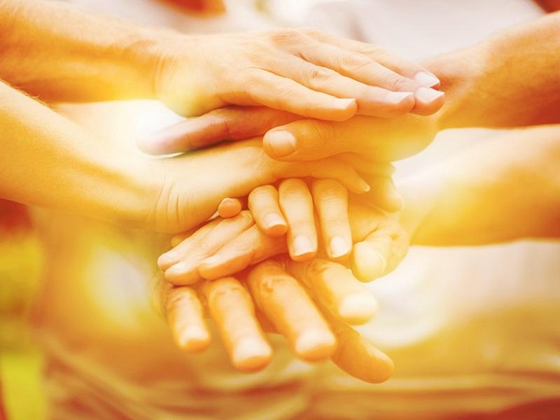 orange hands volunteering