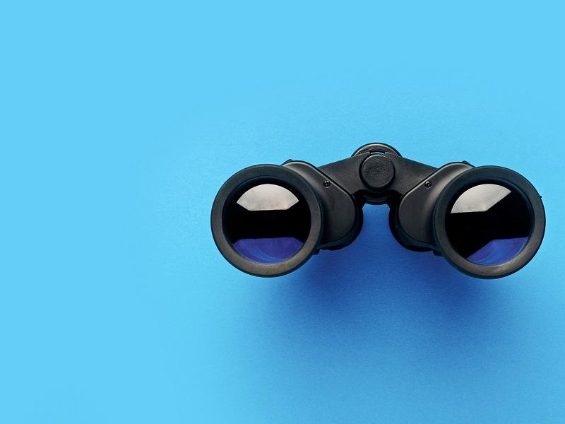 binoculars on blue background